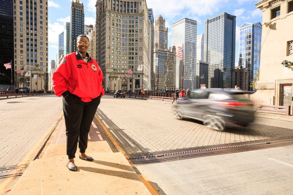 An AmeriCorps member stands in the heart of the city.
